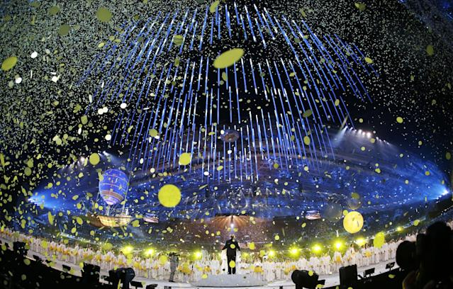 In this photo taken with a fisheye lens, confetti streams from the ceiling as artists perform during the closing ceremony of the 2014 Winter Olympics, Sunday, Feb. 23, 2014, in Sochi, Russia. (AP Photo/Darron Cummings)