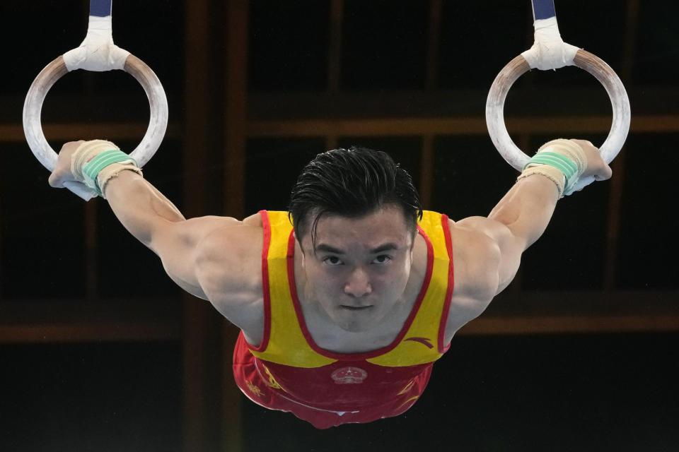 Liu Yang, of China, performs on the rings during the artistic gymnastics men's apparatus final at the 2020 Summer Olympics, Monday, Aug. 2, 2021, in Tokyo, Japan. (AP Photo/Ashley Landis)