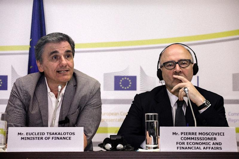 European Commissioner for Economic and Financial Affairs Pierre Moscovici (R), pictured with Greece's Finance Minister Euclid Tsakalotos on July 18, 2016, stressed that the EU and Greece need to reach an agreement on the country's mountain of debt