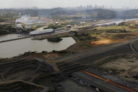 A general view of the Miraflores set of lock (top) on the Pacific side, next to the Panama Canal Expansion Project, in Panama City March 23, 2015. REUTERS/Carlos Jasso