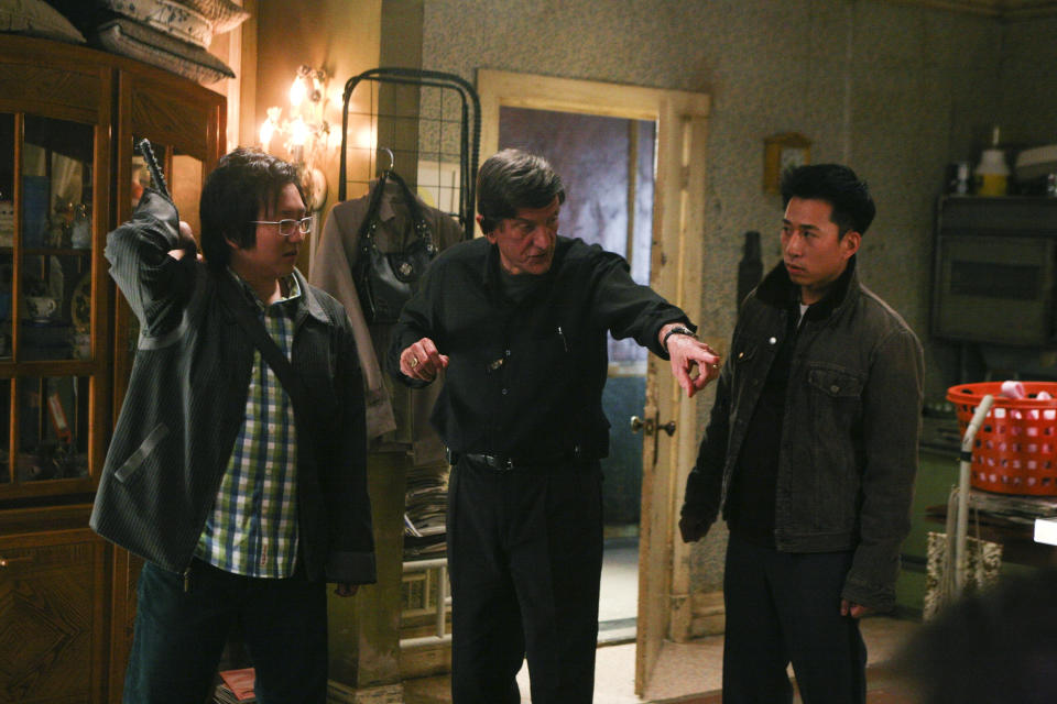 "HEROES -- ""The Hard Part"" Episode 21 -- Aired 5/7/07 --Pictured: (l-r) Masi Oka as Hiro Nakamura, director John Badham, James Kyson Lee as Ando Masahashi  (Photo by Dean Hendler/NBCU Photo Bank/NBCUniversal via Getty Images via Getty Images)"