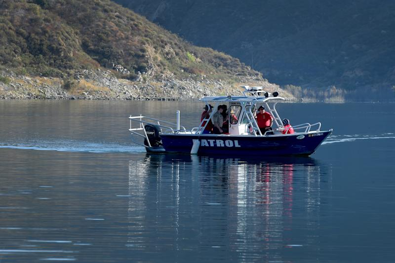 "Search and Rescue teams use boats to look along the northern shore of Lake Piru on Thursday, July 9, 2020, for actress Naya Rivera. The ""Glee"" actress went missing after renting a boat with her 4-year-old son at Lake Piru on Wednesday."