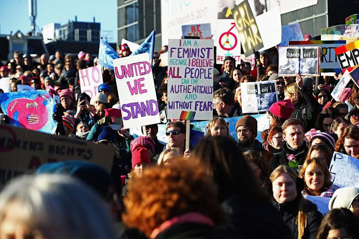 "<p>Demonstrators with a sign saying ""United We Stand and I am a feminist because I believe all people can live authentically and without fear "" make their way from the iamsterdam statue in front of the Rijksmuseum toward the U.S. Consulate during the Women's March in Amsterdam. (Dean Mouhtaropoulos/Getty Images) </p>"