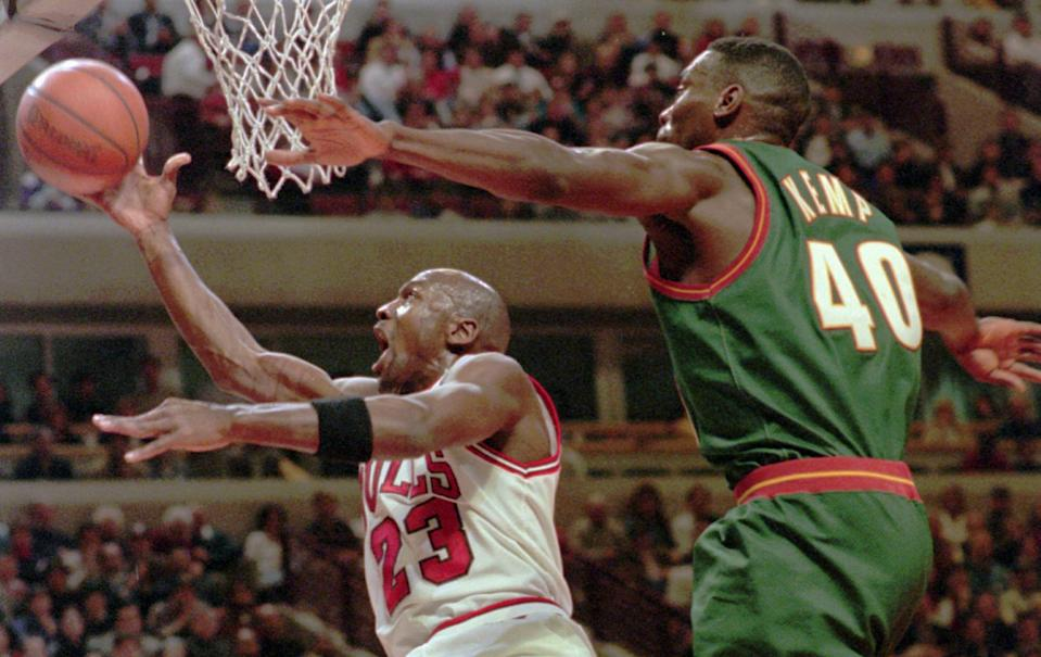 Chicago Bulls' Michael Jordan (23) takes a shot in front Seattle SuperSonics' Shawn Kemp (40) during the first quarter Wednesday, Jan. 10, 1996, in Chicago. (AP Photo/Fred Jewell)