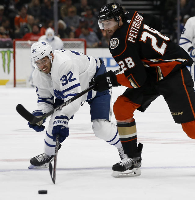 Anaheim Ducks defenseman Marcus Pettersson, right, of Sweden, stops Toronto Maple Leafs left wing Josh Leivo, left, from the puck during the first period of an NHL hockey game in Anaheim, Calif., Friday, Nov. 16, 2018. (AP Photo/Alex Gallardo)