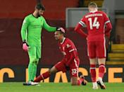 Taking the strain: Liverpool defender Joel Matip (centre) became the latest Premier League player to suffer a muscle injury in Sunday's 1-1 draw with West Brom