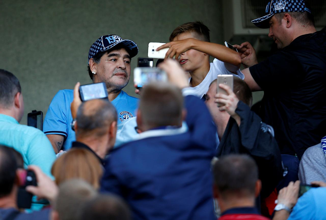 Diego Maradona, Argentina's soccer legend and newly appointed chairman of the board of Dynamo Brest football club, watches the match between Dinamo-Brest and Shakhtyor Soligorsk in Brest, Belarus July 16, 2018. REUTERS/Vasily Fedosenko