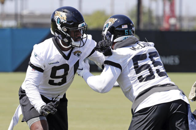 Jacksonville Jaguars defensive end Yannick Ngakoue, left, and defensive end Lerentee McCray (55) perform a drill during the an NFL football practice, Tuesday, May 21, 2019, in Jacksonville, Fla. (AP Photo/John Raoux)