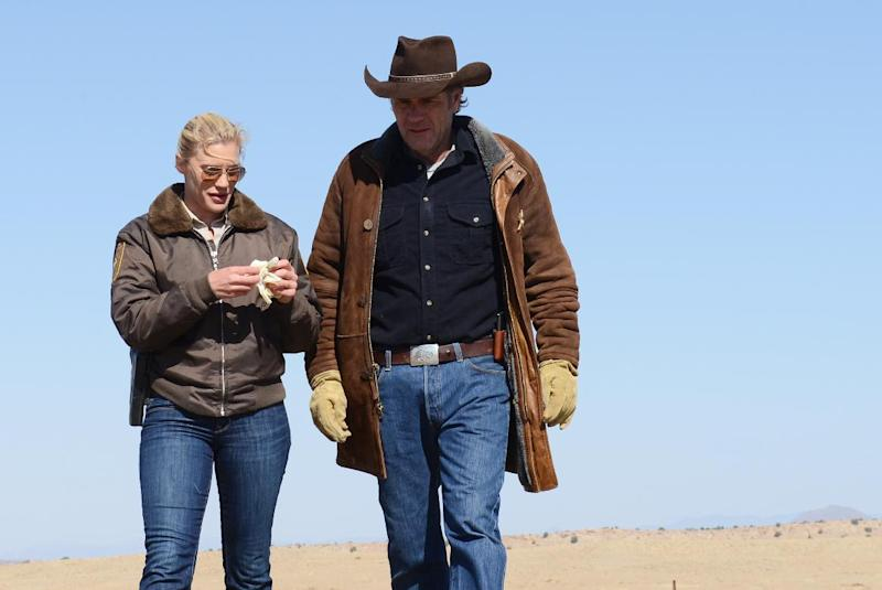 """This undated publicity image released by A&E shows Katee Sackhoff , left, and Robert Taylor in the series """"Longmire,"""" returning for a second season on Monday, May 27 at 10 p.m. on A&E. (AP Photo/A&E, Ursula Coyote)"""