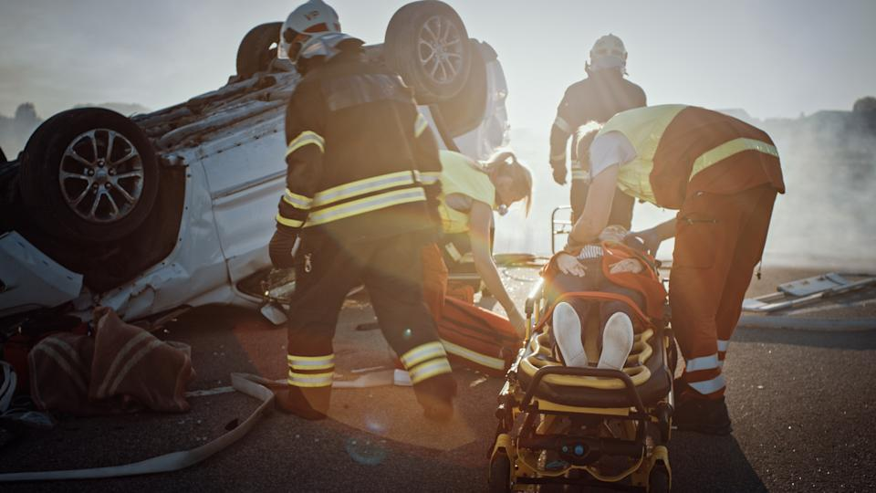 Paramedics rescuing car accident victim. Source: Getty Images