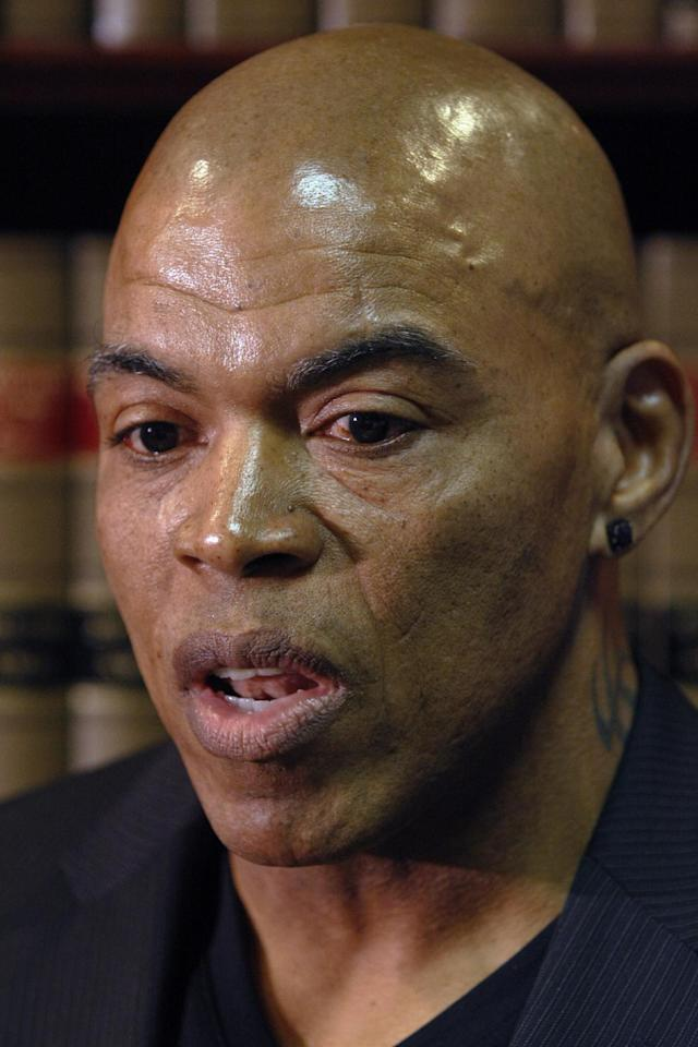 Former Kansas City Chiefs linebacker Chris Martin, describes the injuries he suffered during his football career as he talks about the lawsuit filed today against the Kansas City Chiefs organization during a news conference in Independence, Mo, Tuesday, Dec. 3, 2013. The lawsuit on behalf of five former Kansas City Chiefs players is for failing to disclose the dangers of competing after suffering head injuries. (AP Photo/Colin E Braley)