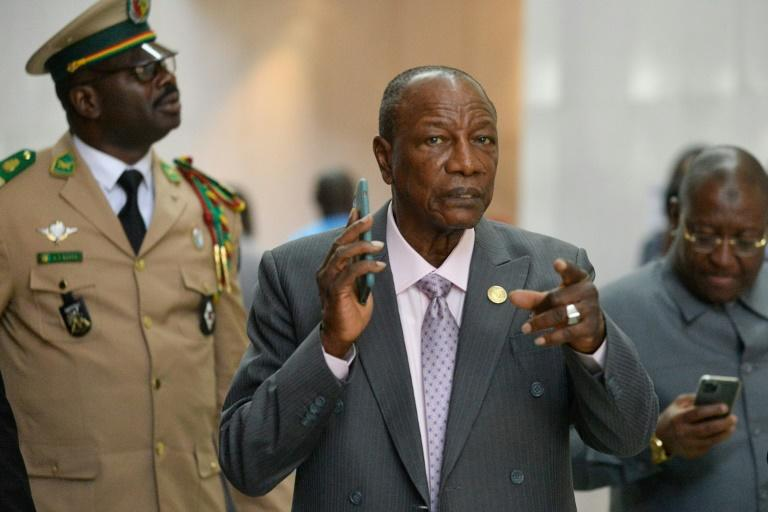 Guinea's President Alpha Conde (C), seen here in early February, did not publicly announce a date for the new referendum
