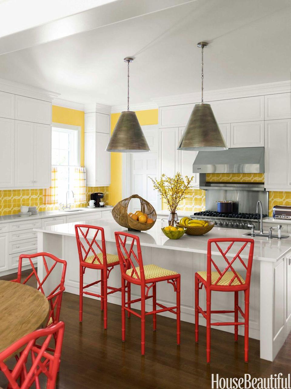 "<p>The tile backsplash was the inspiration for the coordinating yellow-glazed walls in a <a href=""https://www.housebeautiful.com/design-inspiration/house-tours/g1479/colorful-beach-house-decor-0913/?slide=3"" rel=""nofollow noopener"" target=""_blank"" data-ylk=""slk:Naples, Florida, kitchen"" class=""link rapid-noclick-resp"">Naples, Florida, kitchen</a> by Carrier & Company. Red stools make it feel even more vibrant and sharpen things up. </p>"