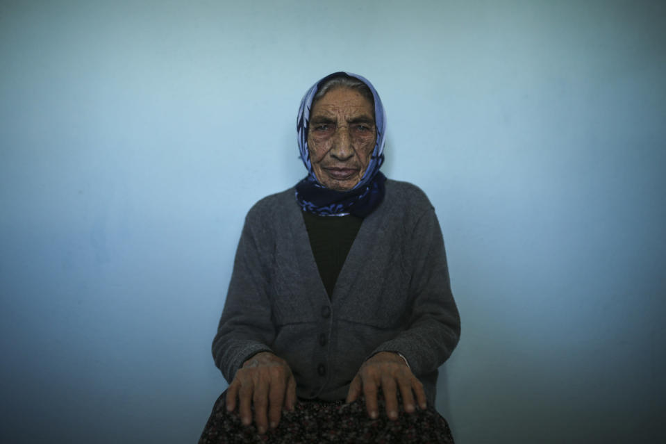 Altun Yigit, 83, rests after she was administered a CoronaVac vaccine made by China's Sinovac Biotech Ltd. by a visiting medical team at her house in the isolated village of Gumuslu of the district of Sivas, central Turkey, Friday, Feb. 26, 2021. (AP Photo/Emrah Gurel)