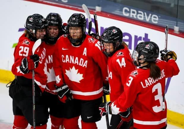 Canada's Renata Fast, centre-left, celebrates her goal with teammates during the first period of a semifinal win over Switzerland in the IIHF women's world championship on Monday in Calgary. (Jeff McIntosh/The Canadian Press - image credit)