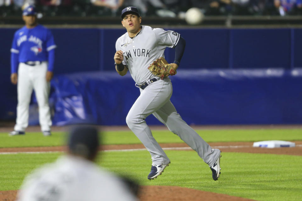New York Yankees third baseman Gio Urshela watches his throw to first for the out on Toronto Blue Jays' Bo Bichette during the eighth inning of a baseball game Wednesday, June 16, 2021, in Buffalo, N.Y. (AP Photo/Jeffrey T. Barnes)