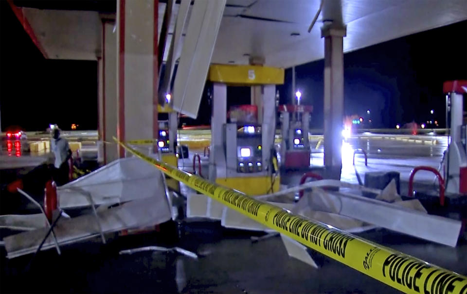 In this image made from video, debris from tornadoes pile around the pumps of a filling station late Sunday, Oct. 10, 2021, in Shawnee, Oklahoma. Several reported tornadoes ripped through Oklahoma late Sunday into early Monday morning, causing damage but no immediate word of deaths or injuries. (KWTV via AP)
