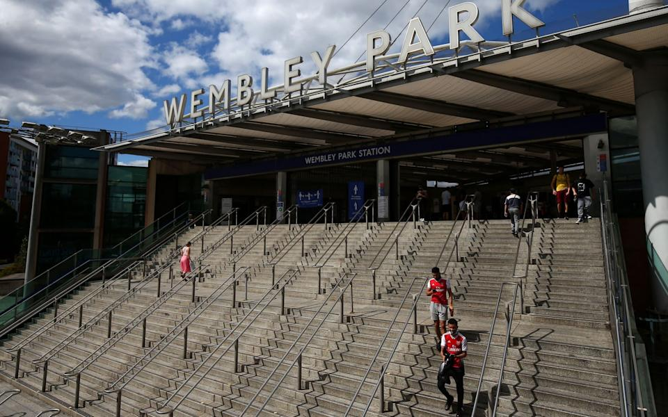 Arsenal fans arrive at Wembley Park Station prior to the FA Cup Final match between Arsenal and Chelsea at Wembley Stadium - GETTY IMAGES