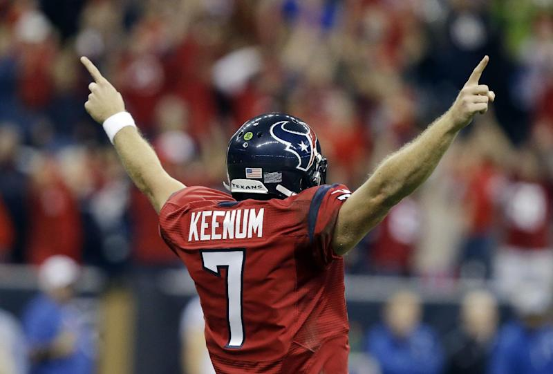 Houston Texans' Case Keenum celebrates teammate Andre Johnson's touchdown during the first quarter of an NFL football game against the Indianapolis Colts, Sunday, Nov. 3, 2013, in Houston. (AP Photo/Patric Schneider)