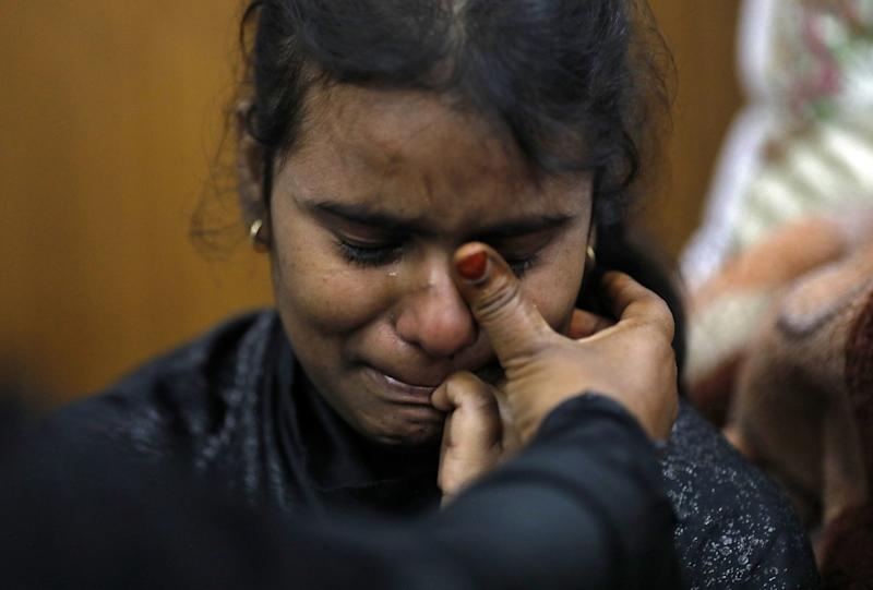 A Muslim girl is consoled in a shelter camp after she and her family fled their home during the Delhi Riots in February. (Photo: Adnan Abidi / Reuters)