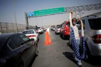 FILE PHOTO: Vehicles wait in line to cross into the U.S, in Ciudad Juarez