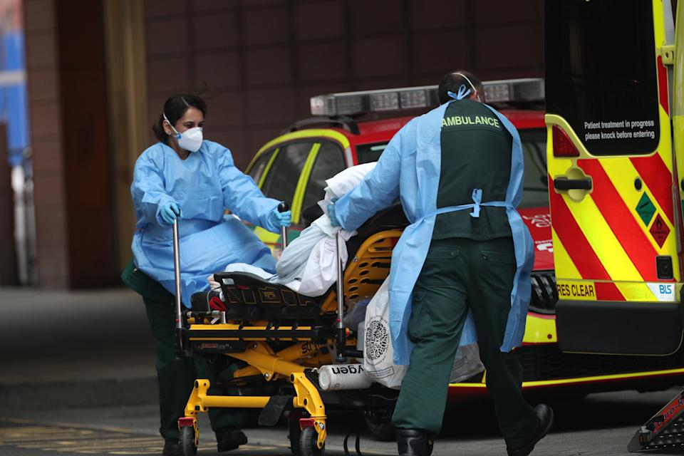 A patient is transported outside the Royal London Hospital on Thursday. (Yui Mok/PA)