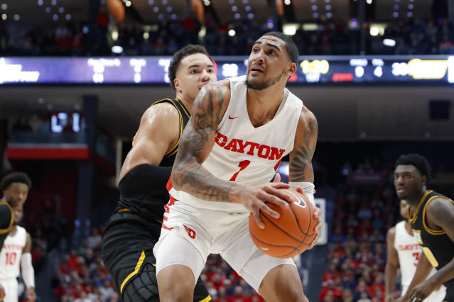 Dayton's Obi Toppin (1) eyes the basket against Virginia Commonwealth's Marcus Santos-Silva, left, during the first half of an NCAA college basketball game, Tuesday, Jan. 14, 2020, in Dayton, Ohio. (AP Photo/John Minchillo)