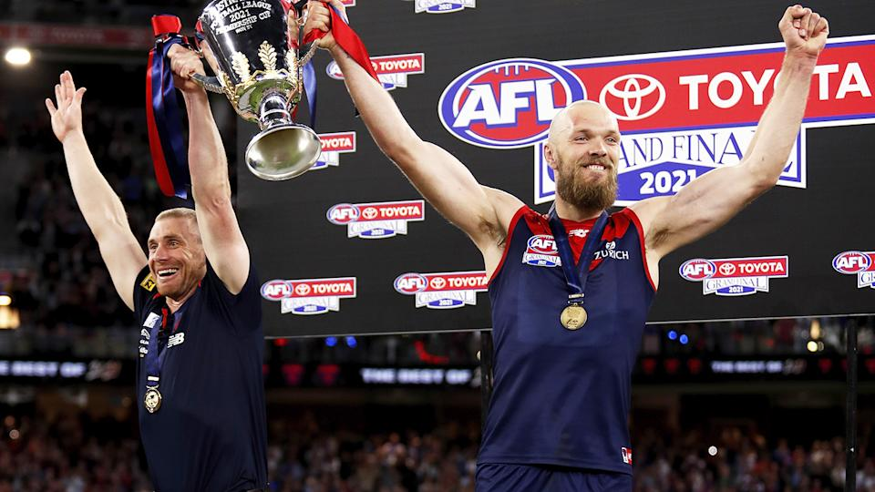 Simon Goodwin and Max Gawn, pictured here celebrating with the premiership cup after the AFL grand final.