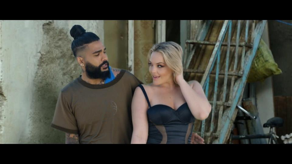 "This photo provided by AZ Films shows California based Iranian pop singer Sasy with American adult film actress Alexis Texas in the music video for ""Tehran Tokyo."" on Feb 26, 2021 in Los Angeles. Iranian authorities have arrested multiple music producers connected to the California-based Iranian pop singer, his management company and Iranian media said Thursday, March 11, in Tehran's latest effort to halt what it deems decadent Western behavior. (AZ Films via AP)"