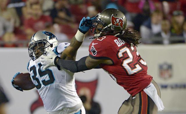 Carolina Panthers fullback Mike Tolbert (35) is called for a face mask penalty as he tries to get past Tampa Bay Buccaneers strong safety Mark Barron (23) during the first half of an NFL football game in Tampa, Fla., Thursday, Oct. 24, 2013. (AP Photo/Phelan M. Ebenhack)