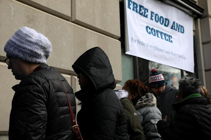 Federal workers left unpaid or furloughed by the extended partial government shutdown stand in line for fresh food and coffee at the World Central Kitchen, a volunteer emergency kitchen run by Chef Jose Andres, in Washington, Jan.16, 2019. (Photo: Jonathan Ernst/Reuters)
