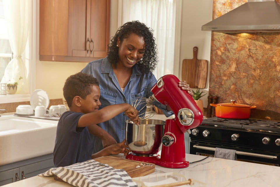 Mother and son baking together using Cuisinart stand mixer from Canadian Tire