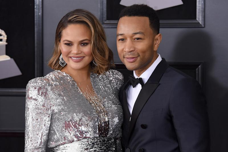 Chrissy Teigen with her husband, John Legend. (Presley Ann via Getty Images)