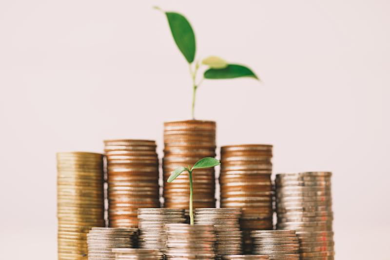 Coins stack and seedling on top. Watering can and money tree drawn concept for business investment. Time counting down for retirement.