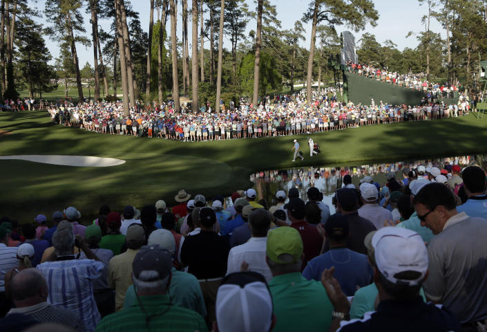 Jordan Spieth walks down the 16th fairway during the third round of the Masters golf tournament Saturday, April 11, 2015, in Augusta, Ga. (AP Photo/Charlie Riedel)