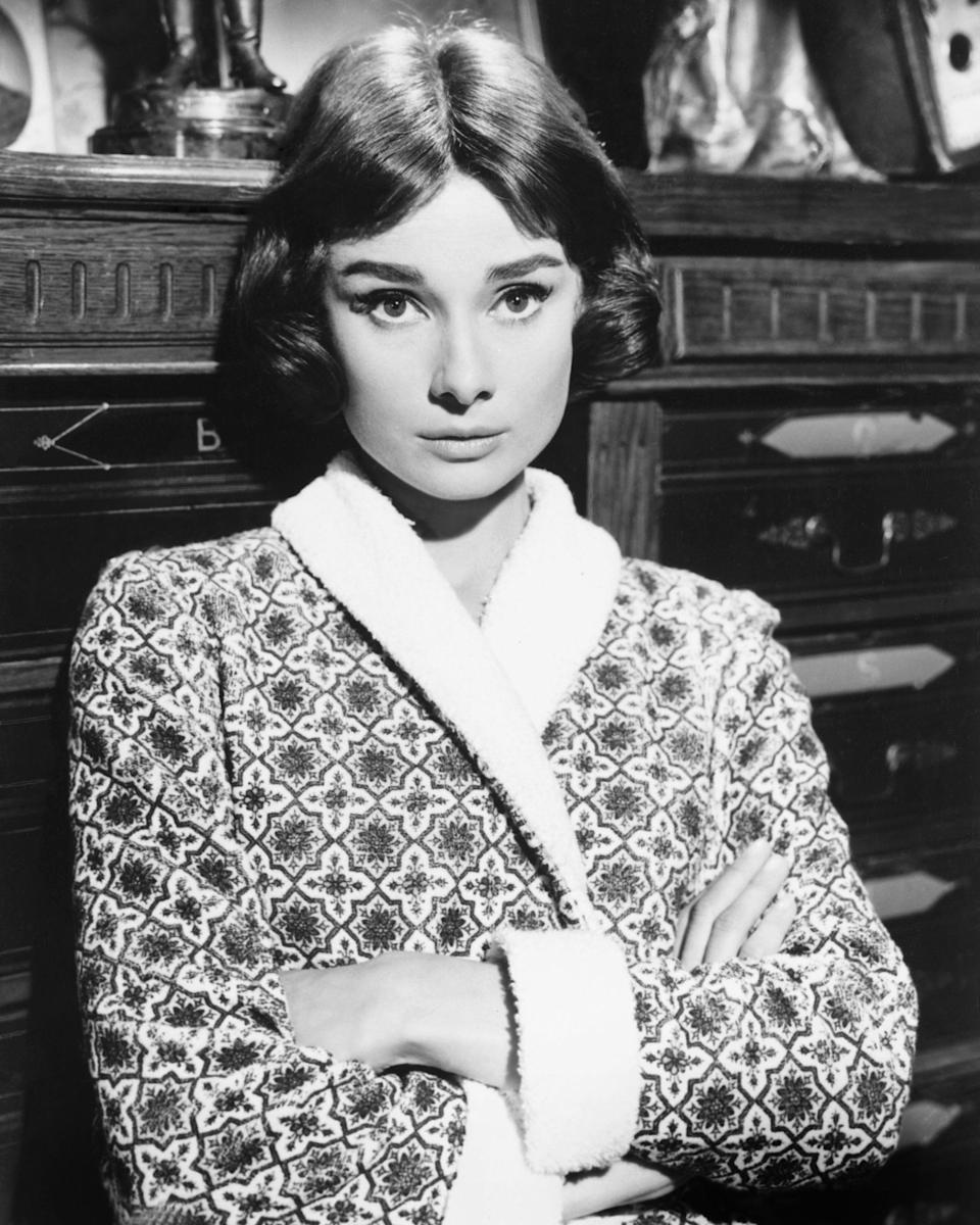 Hepburn photographed in 1955 wearing a patterned robe.