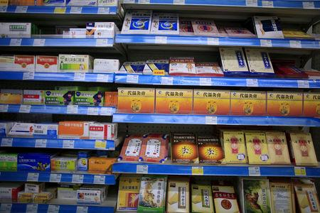 Shelves displaying medicines are seen at a pharmacy in Shanghai, China, November 27, 2015. REUTERS/Aly Song/File Photo