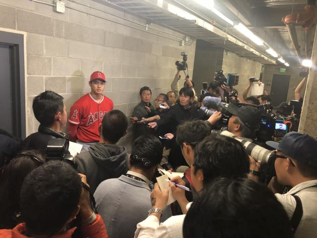 Shohei Ohtani talks to reporters after his third spring training game. (Yahoo Sports)