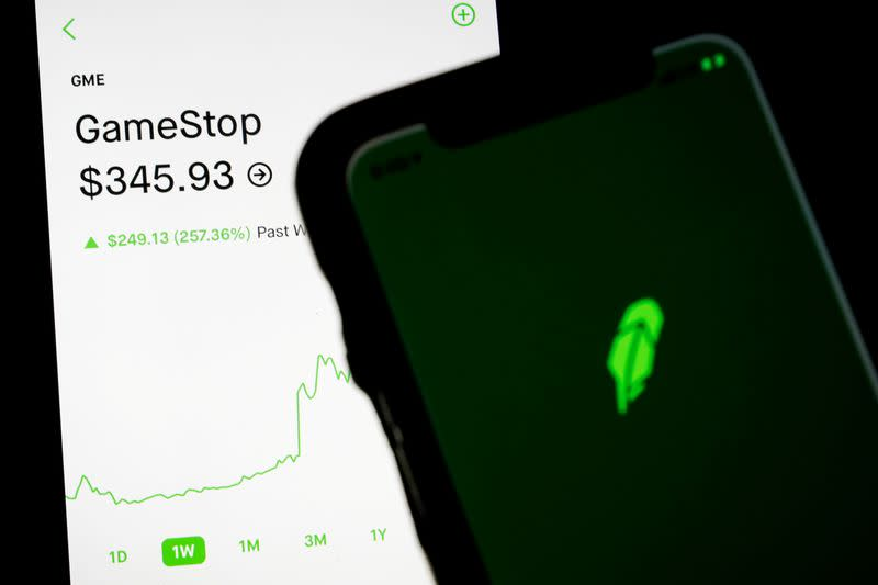 FILE PHOTO: Trading information for GameStop is displayed on the Robinhood App as another screen displays the Robinhood logo