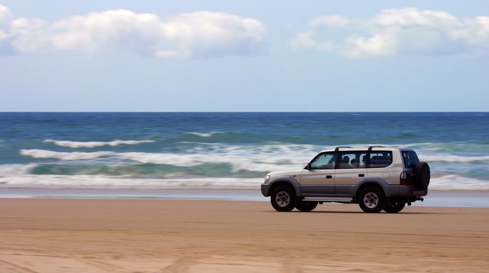 4x4 vehicle driving on beach. Source: Getty Images