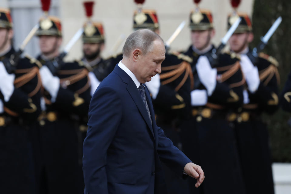 Russian President Vladimir Putin walks past Republican guards as he arrives at the Elysee Palace Monday, Dec. 9, 2019 in Paris. A long-awaited summit in Paris is aiming to find a way to end the war in Ukraine, after five years and 14,000 lives lost in a conflict that has emboldened the Kremlin and reshaped European geopolitics. (AP Photo/Thibault Camus)