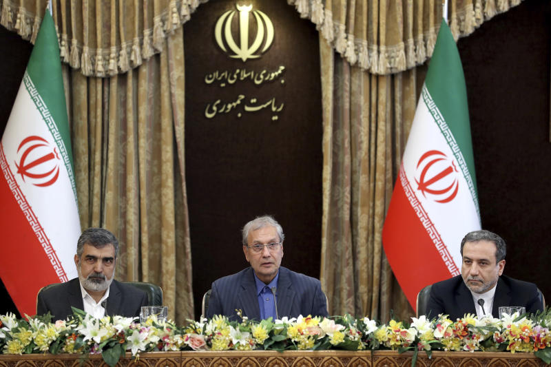 "From left to right, spokesman for Iran's atomic agency Behrouz Kamalvandi, Iran's government spokesman Ali Rabiei and Iranian Deputy Foreign Minister Abbas Araghchi, attend a meeting in Tehran, Iran, Sunday, July 7, 2019. The deputy foreign minister says that his nation considers the 2015 nuclear deal with world powers to be a ""valid document"" and seeks its continuation. (AP Photo/Ebrahim Noroozi)"