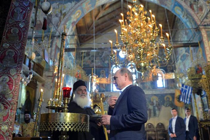 Russian President Vladimir Putin's visit to one of Orthodox Christianity's holiest sites was the last leg of his two-day trip to Greece (AFP Photo/Alexey Druzhinin)