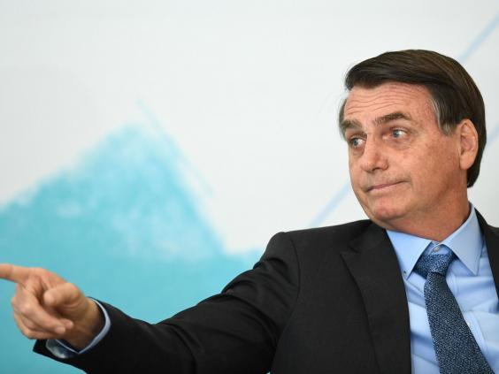 Jair Bolsonaro has rejected worldwide offers of aid to abate the fires as 'colonialism' (AFP/Getty Images)