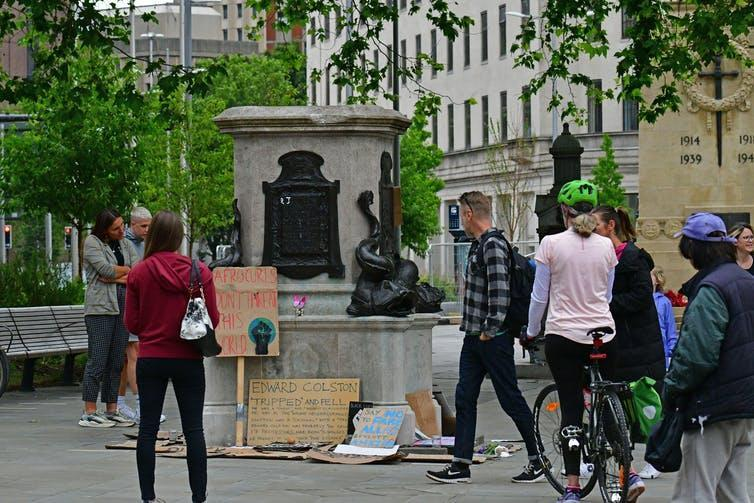 Crowd gathers in front of empty plinth where Bristol's Edward Colston statue once stood