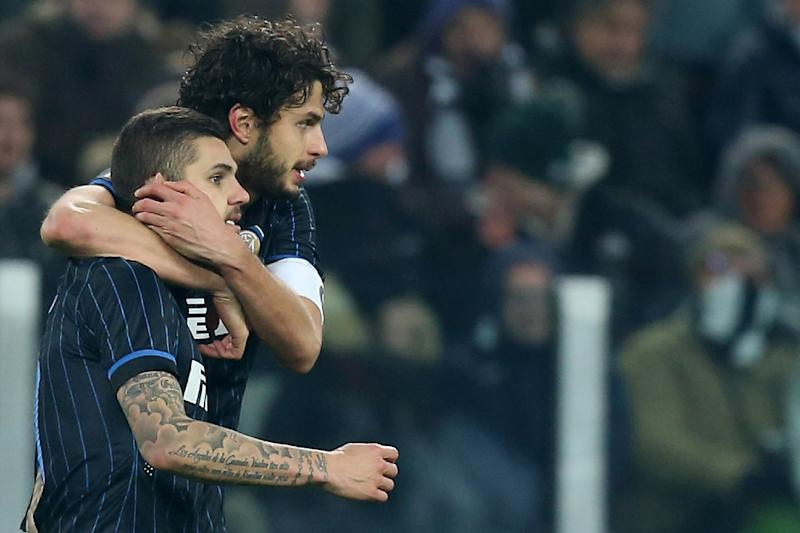 Inter Milan's Mauro Emanuel Icardi (L) and Andrea Ranocchia celebrate a goal against Juventus in January