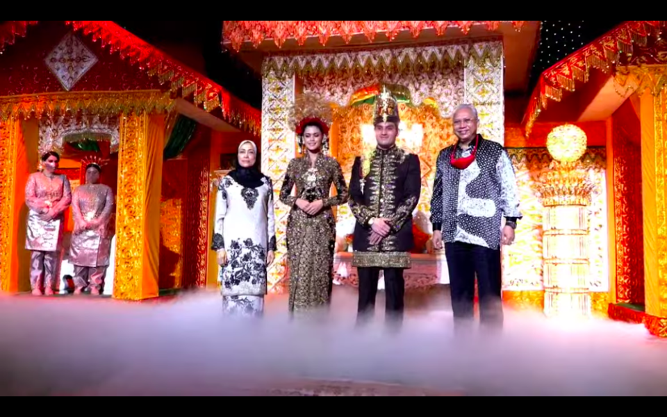 Datuk Seri Tengku Adnan Mansor's son Muhammad Hafiz and wife Oceane Cyril Alogia pose for a picture with Tan Sri Annuar Musa and his wife at their wedding reception December 20, 2020. — Screenshot from https://hafizoceane.com/live/