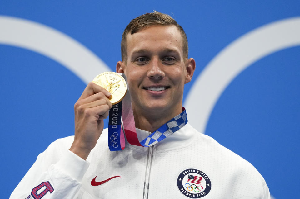 Caeleb Dressel, of United States, poses after winning the gold medal in the men's 50-meter freestyle final at the 2020 Summer Olympics, Sunday, Aug. 1, 2021, in Tokyo, Japan. (AP Photo/Gregory Bull)
