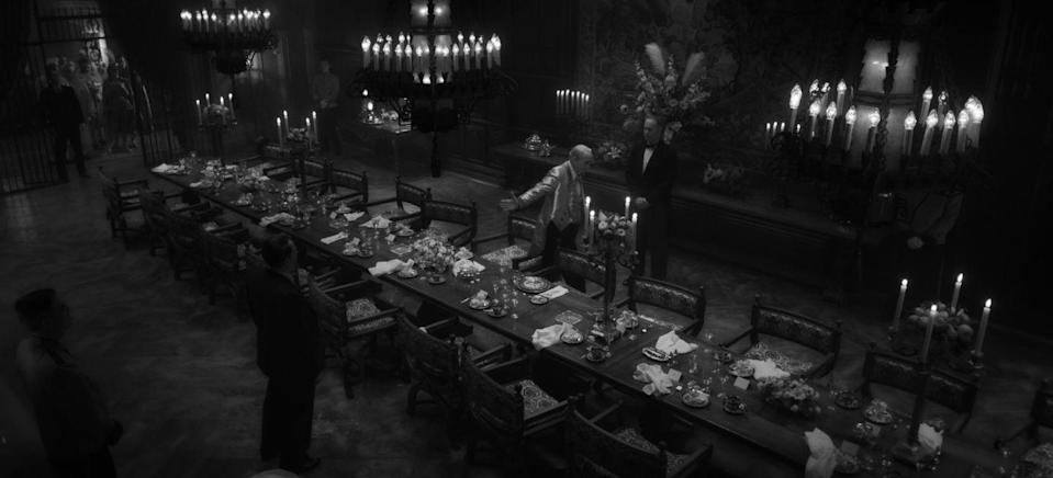 <p><strong>Production design by Donald Graham Burt; set decoration by Jan Pascale.</strong></p><p>David Fincher's <em>Mank </em>is based on screenwriter Herman Mankiewicz's (portrayed by Gary Oldman) time writing the script for the iconic film <em>Citizen Kane</em>. Coming in with 10 nominations, <em>Mank</em> is one of the most buzzed-about films of the year. Production designer Donald Graham Burt and Fincher have been working together since <em>Zodiac</em> (2007) and are clearly a winning combination. They've collaborated on Academy Award–nominated films (and winners) such as <em>The Curious Case of Benjamin Button</em> (2008), <em>The Social Network</em> (2010), and <em>The Girl with the Dragon Tattoo</em> (2011).</p><p>For <em>Mank</em>, Graham Burt had to create authentic sets to accurately convey the Golden Age of Hollywood <em>and</em> think about how the sets photographed in black and white. ''There was certainly a learning curve in approaching the black-and-white aspect of the film,'' Graham Burt told <em>ELLE Decor </em>in an e-mail. ''We couldn't scenic the interiors in tones of orange and green merely because it photographed well, as it would be too jarring and distracting to the actors and take away from the reality we were attempting to portray. We developed a language of colors that, combined with glazes, functioned to keep the sets feeling real while also lending themselves to the richness of the black and white.''</p><p>If you asked the designer what the most challenging part was, it would be recreating the Hearst Castle, formerly called the San Simeon estate, where the lavish parties were set. Since filming was not allowed on the estate, Graham Burt was left with two options: scout similar-looking locations or recreate the famous structure. He went with the latter and managed to build it on a soundstage in eight weeks. The castle emulated many different architectural styles, among them, Spanish Colonial, Classical, and Gothic. But the most illumina
