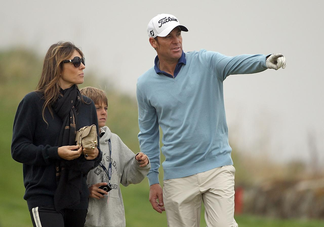 KINGSBARNS, SCOTLAND - OCTOBER 01:  Shane Warne with Elizabeth Hurley and her son Damian during the third round of The Alfred Dunhill Links Championship at the Kingsbarns Golf Links on October 1, 2011 in Kingsbarns, Scotland. It was reported overnight that Miss Hurley excepted a marriage proposal from Shane Warne.  (Photo by Andrew Redington/Getty Images)